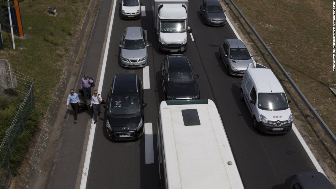 Cars get stuck in a traffic jam on the way to the Paris Orly Airport  on June 25.
