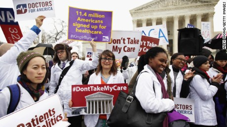 Supporters of the Affordable Care Act gather in front of the Supreme Court during a rally March 4, 2015 in Washington, D.C.