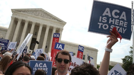 People celebrate in front of the US Supreme Court after ruling was announced on the Affordable Care Act June 25.