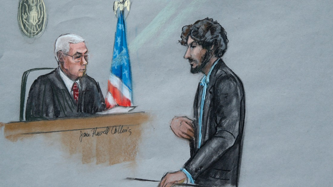 In this courtroom sketch, Boston Marathon bomber Dzhokhar Tsarnaev, right, stands before U.S. District Judge George O'Toole Jr. as he addresses the court during his sentencing, Wednesday, June 24, 2015, in federal court in Boston. Tsarnaev apologized to the victims and their loved ones for the first time Wednesday just before the judge formally sentenced him to death. (Jane Flavell Collins via AP)
