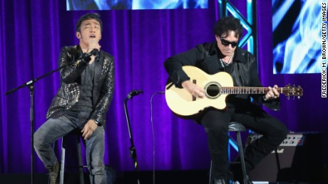 "(L-R) Journey band members lead vocalist Arnel Pineda and guitarist Neal Schon perform onstage during the ""Don't Stop Believin': Everyman's Journey"" panel at the PBS portion of the 2013 Summer Television Critics Association tour at the Beverly Hilton Hotel on August 6, 2013 in Beverly Hills, California."