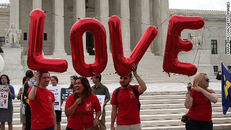 WASHINGTON, DC - JUNE 25: Supporters for and against gay marriage gather in front of the Supreme Court Building June 25, 2015 in Washington, DC. The high court is expected rule in the next few days on whether states can prohibit same sex marriage, as 13 states currently do. (Photo by Mark Wilson/Getty Images)