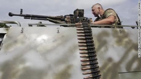 Ukrainian troops stand guard in Krimskoe town of Luhansk, Ukraine on June 25.
