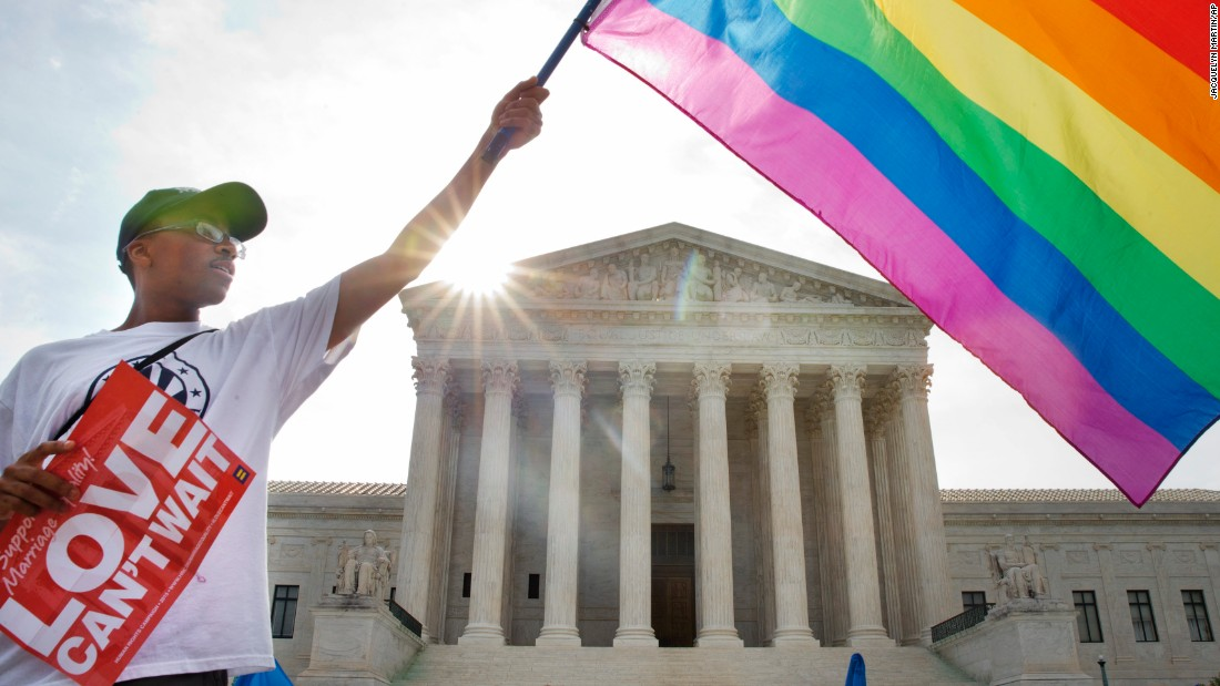 "Carlos McKnight of Washington waves a flag in support of same-sex marriage outside the U.S. Supreme Court on June 26, 2015. <a href=""http://www.cnn.com/2015/06/26/politics/supreme-court-same-sex-marriage-ruling/index.html"">The Supreme Court ruled 5-4</a> that states cannot ban same-sex marriage, handing gay rights advocates their biggest victory yet. See photos from states that approved same-sex marriage before the nationwide ruling:"