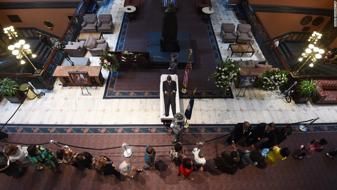 Mourners pay their respects to Pinckney as his body lies in the State House on June 24.
