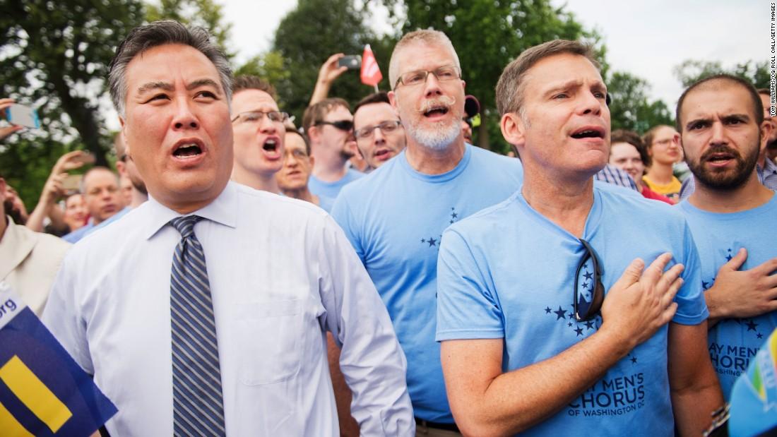 U.S. Rep. Mark Takano of California sings the national anthem June 26 with members of the Gay Men's Chorus of Washington.