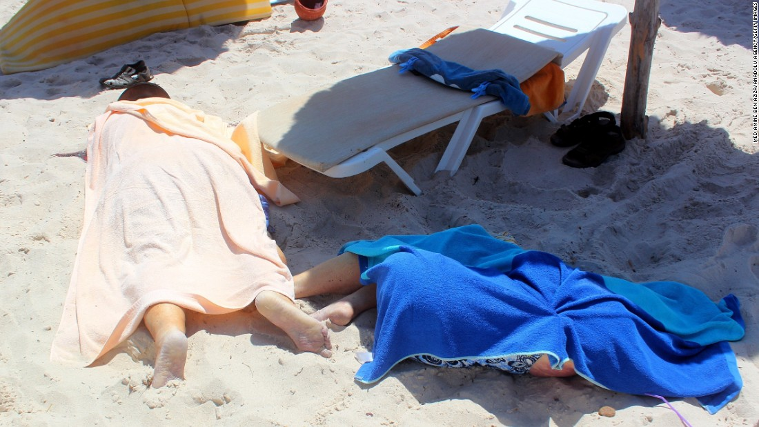 Dead bodies are seen on the beach.