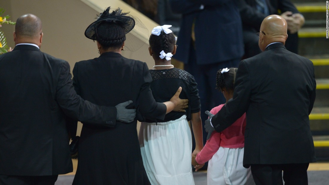 The Pinckney family walks together before Obama's eulogy.