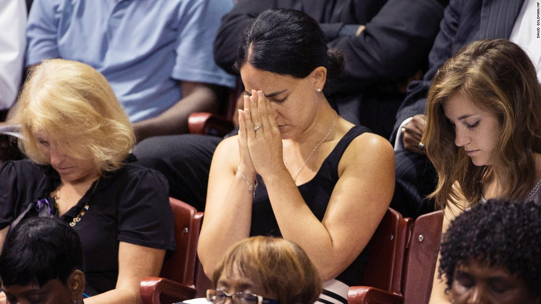 Mourners pray during the service.