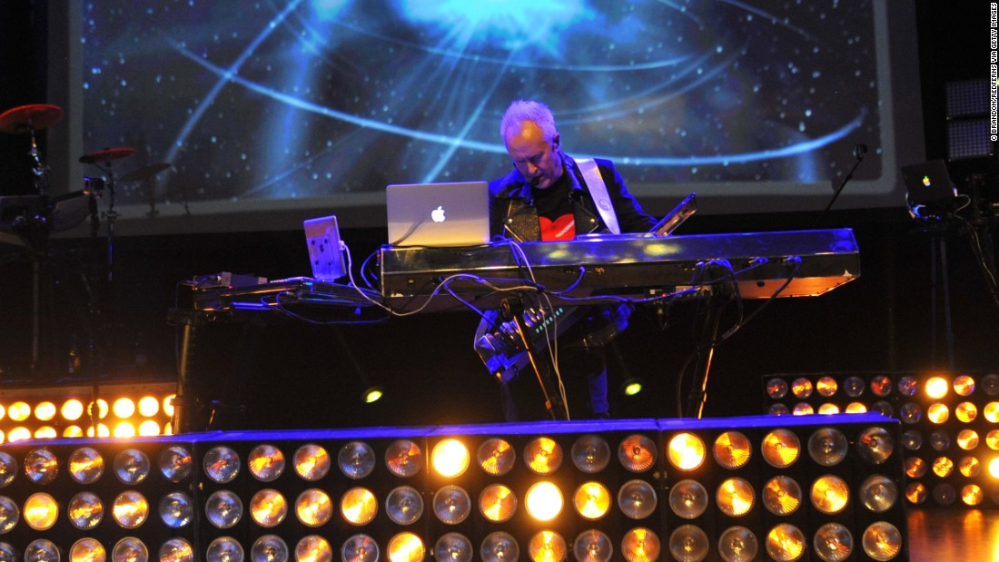 "Celebrating his <a href=""http://www.howardjones.com/news.html"" target=""_blank"">60th birthday with a North American tour</a>, Howard Jones now includes interactive multimedia elements as part of his performance. When he's not touring, Jones lives in Somerset, England. Here he performs in London in 2013."