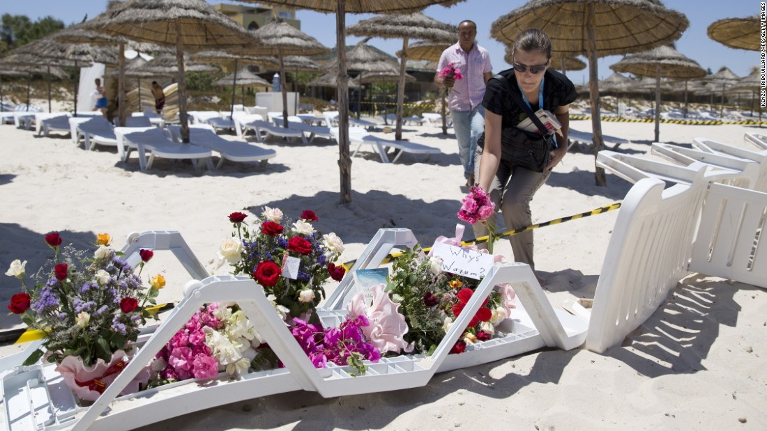 "People lay flowers on the beach in front of Hotel Riu Imperial Marhaba, in the coastal city of Sousse, Tunisia, on Saturday, June 27. Gunmen <a href=""http://www.cnn.com/2015/06/26/africa/tunisia-terror-attack/index.html"" target=""_blank"">killed at least 38 people at site</a>, the same day terrorists lashed out brutally in France and bombed a mosque in Kuwait."