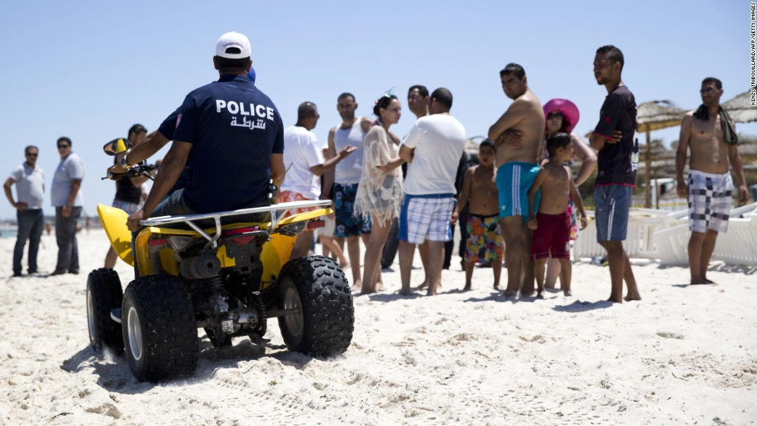 Tunisian police patrol the beach in front of the Riu Imperial Marhaba Hotel on June 27.