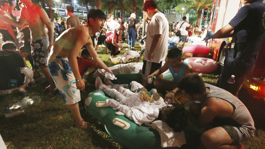 Emergency rescue workers and concert spectators tend to injured victims at the Formosa Water Park in New Taipei City, Taiwan, Saturday, June 27, after flammable powder apparently exploded in mid-air, according to the East Asian nation's official Central News Agency reported.