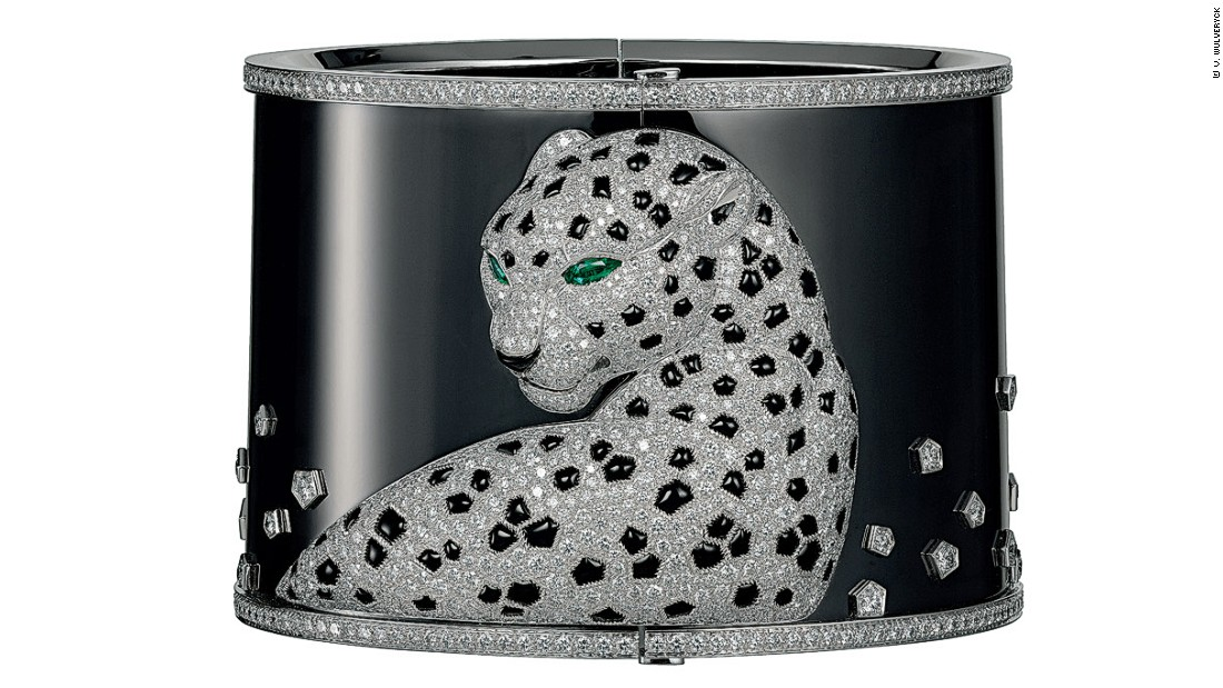A watch-cuff bracelet made from white gold and set with 937 brilliant-cut diamonds, two emeralds, and onyx in 2013.