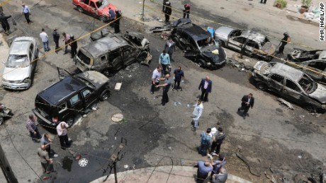 Security personnel check damage Monday in Cairo after an explosion targeted Egypt's prosecutor general.