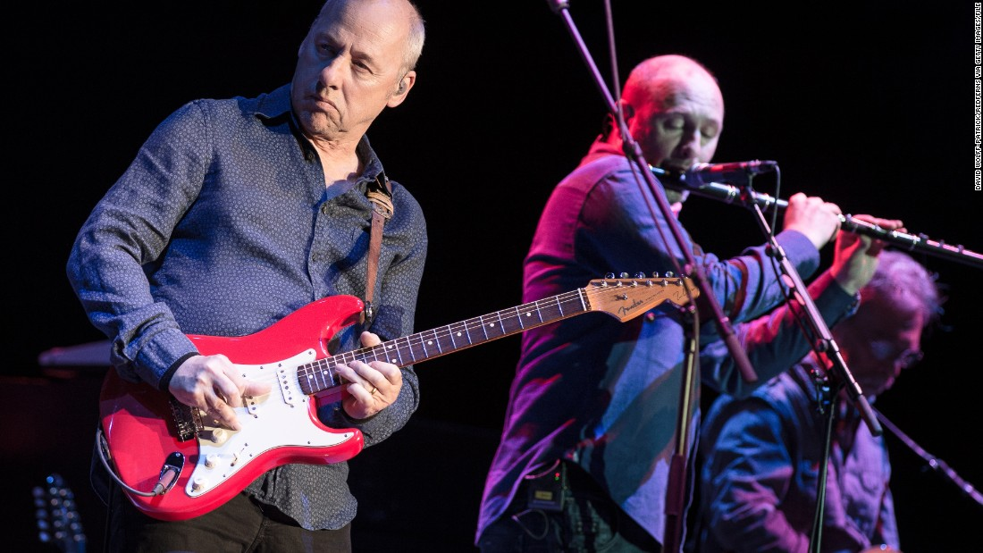 "Frontman Mark Knopfler, left, sang to the Live Aid audience about how to get ""money for nothing and chicks for free."" Nowadays, he's touring in support of <a href=""http://www.markknopfler.com/about/"" target=""_blank"">his new album, ""Tracker</a>."" Here, he performs in Paris in 2013."