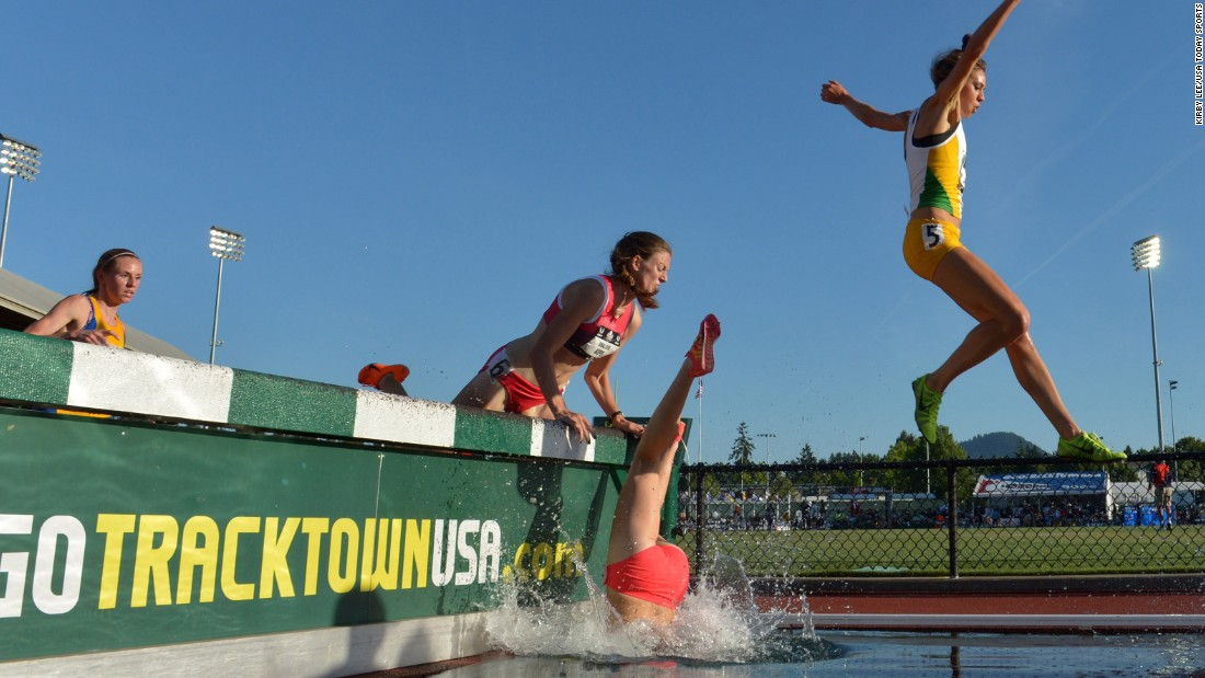 Nicole Bush falls into the water Thursday, June 25, while running the 3,000-meter steeplechase at the U.S. Track and Field Championships. She finished the race.