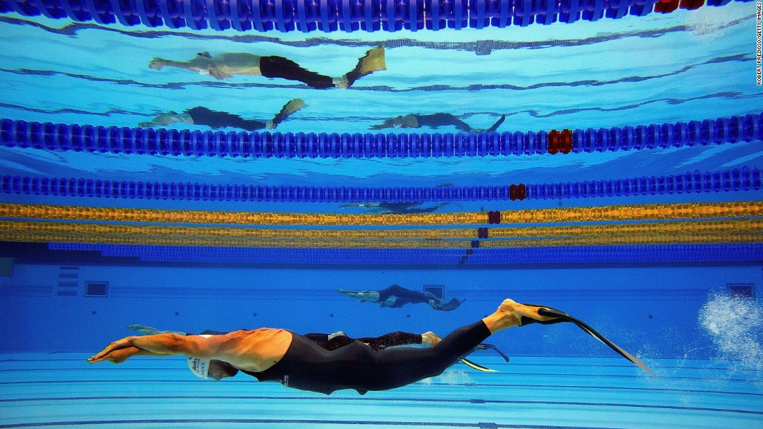 Men swim underwater during one of the finswimming exhibitions at the European Games on Saturday, June 27.