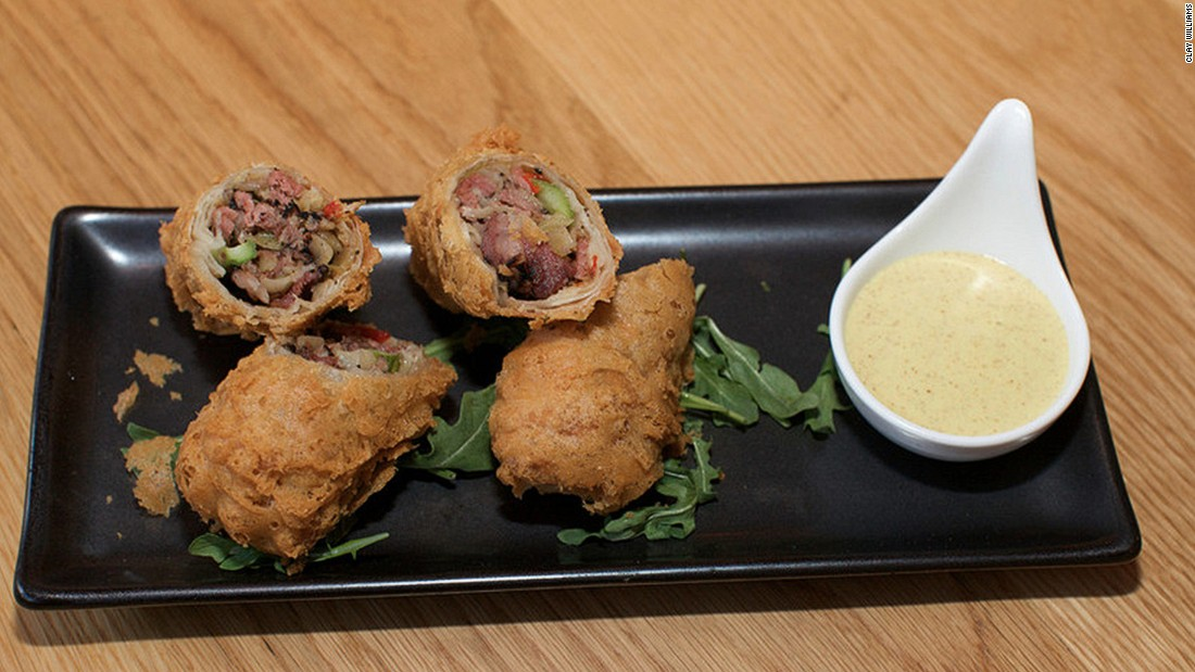 The distinctive dishes found at New York's Red Farm restaurant include Katz Pastrami Egg Rolls, which come with a tasty mustard dip.