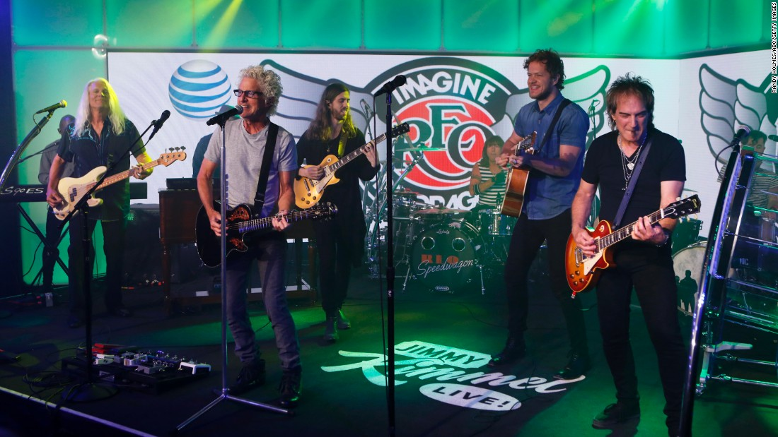"Most members of REO Speedwagon who played at Live Aid are still with the band 30 years later: singer Kevin Cronin, at the mic; keyboardist Neal Doughty, hidden; bassist Bruce Hall, second from left; and drummer Alan Gratzer. The band appeared recently on TV's ""Jimmy Kimmel Live!"" with Imagine Dragons."