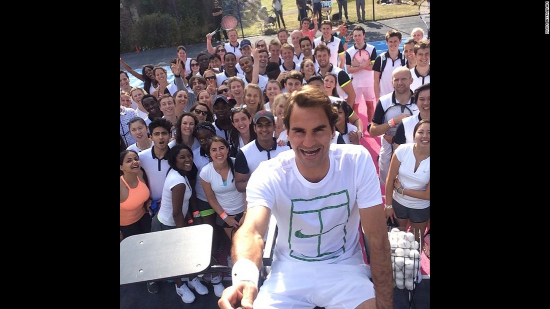 "Tennis star Roger Federer <a href=""https://instagram.com/p/4XqtDxgvzb/"" target=""_blank"">takes a selfie with fans</a> on Thursday, June 25."