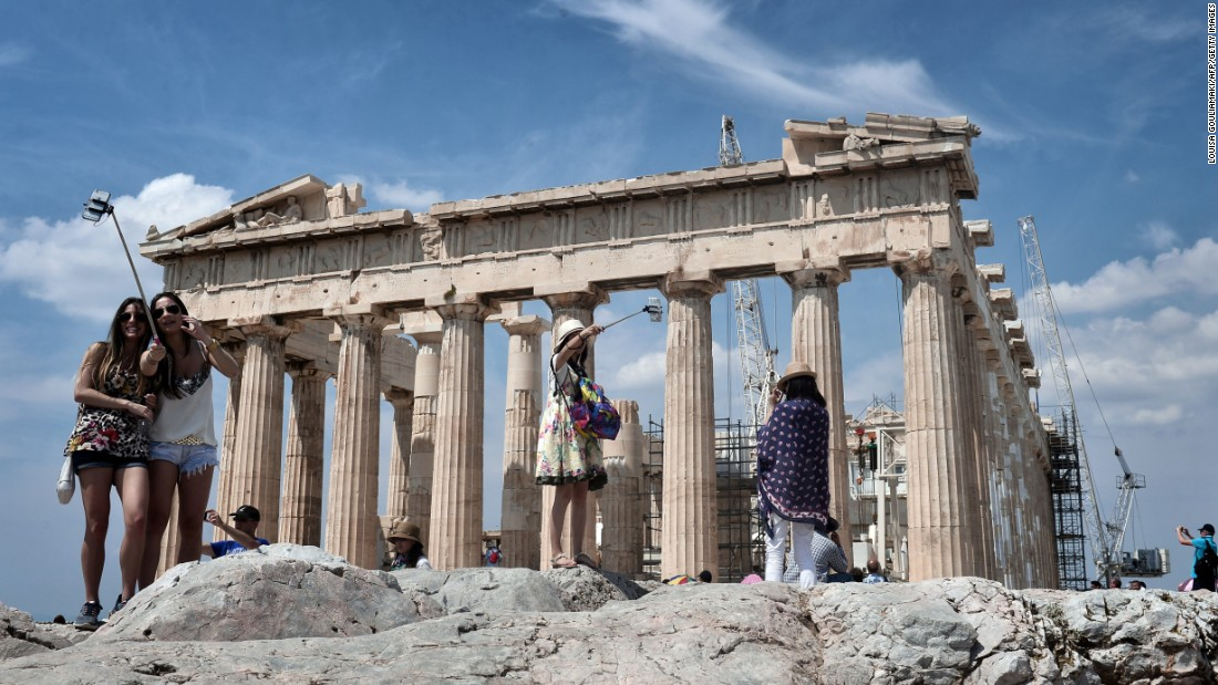 "Tourists take selfies as they visit the Acropolis in Athens, Greece, on Tuesday, June 30. <a href=""http://www.cnn.com/2015/06/24/living/gallery/selfies-look-at-me-0624/index.html"" target=""_blank"">See 27 selfies from last week</a>"
