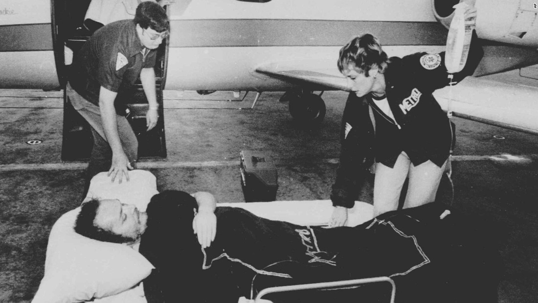 "Larry Flynt, owner of Hustler magazine, lies on a stretcher in Atlanta, April 14, 1978, as attendants prepare to load him on board a hospital plane. Flynt was shot by serial killer and white supremacist <a href=""http://www.cnn.com/2013/11/18/justice/death-row-interview-joseph-paul-franklin/"">Joseph Paul Franklin</a> for publishing pornographic photos of a black man with a white woman. The injury left Flynt permanently paralyzed from the waist down. Franklin was convicted of six murders and claimed responsibility for as many as 22. He was executed in November 2013."