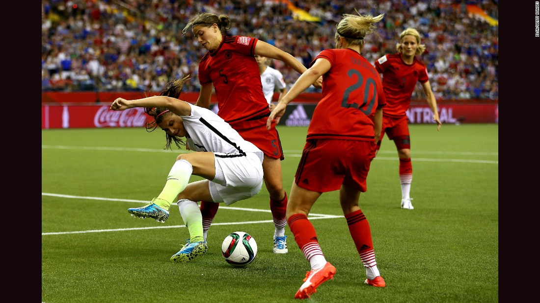 U.S forward Alex Morgan is defended by Germany's Annike Krahn, left, and Lena Goessling.