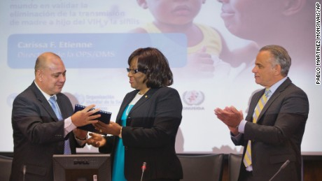 World health officials congratulate Cuban health leaders on elimination of mother-to-child transmission of HIV.