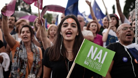 Pro-Euro protesters gather in front of the parliament building in Athens on June 30, 2015.