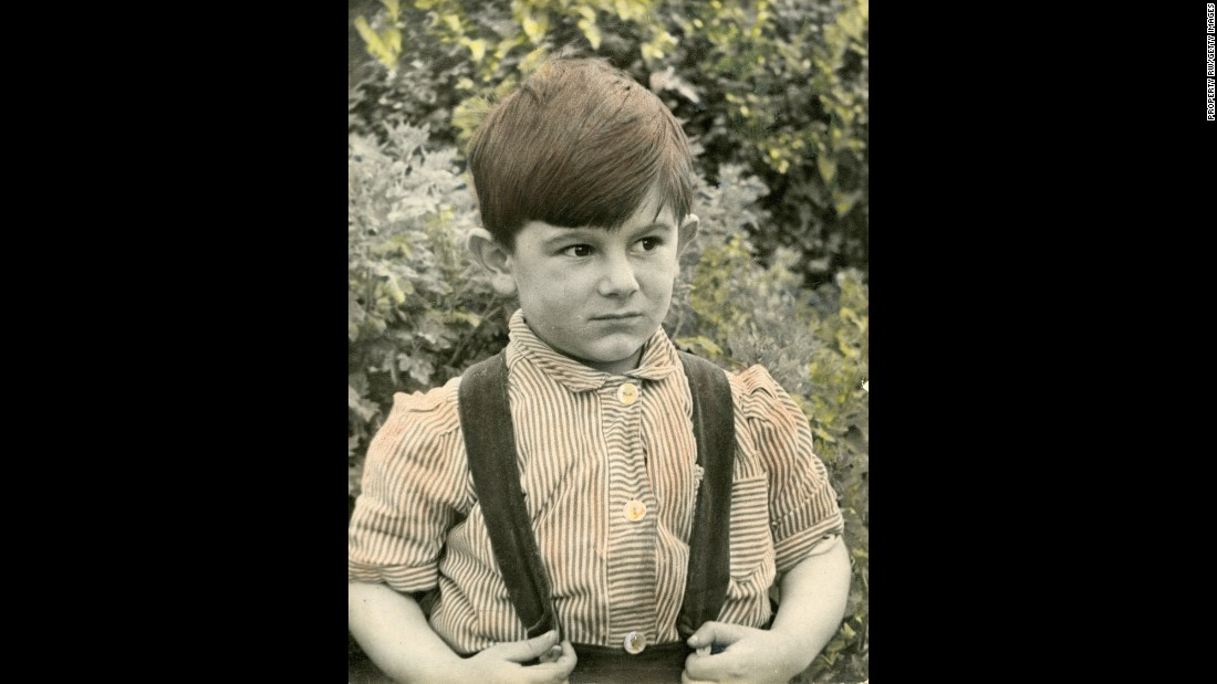 Wood, age 4, at his London home in 1951. By the time he joined the Stones, he had established himself as a musician, having already played with The Birds and the Faces.