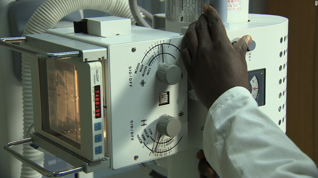 A doctor operates a scanning machine at the Machakos Hospital.