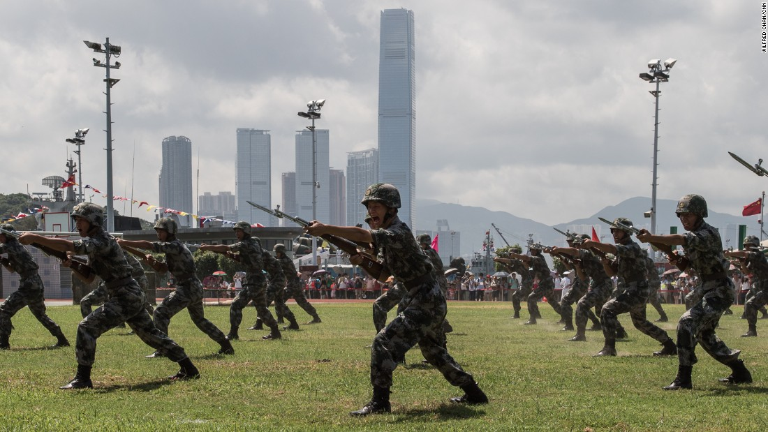 Soldiers perform a drill not far from the International Commerce Center (ICC), the city's tallest skyscraper.
