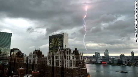 With the United Nations and Tudor City in the foreground, lightning strikes in the sky over the East River  as a major storm approaches New York City July 2, 2014.