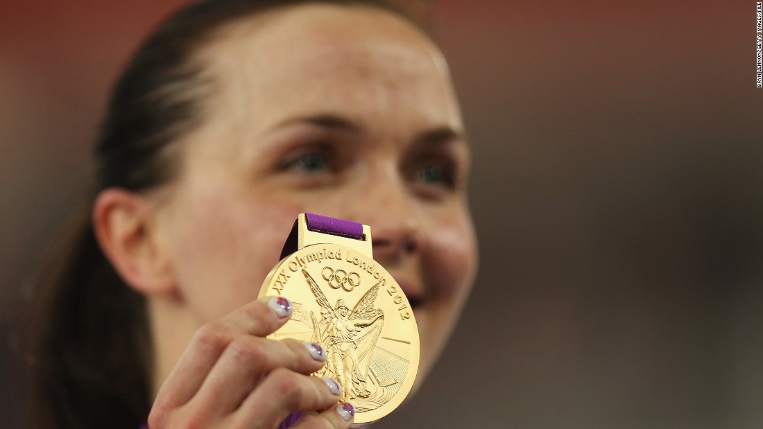 Pendleton shows off her gold medal won in the Keirin competition at the 2012 London Games. The Briton is the most successful British female Olympian ever winning two golds and one silver.