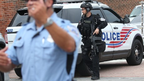 Law enforcement officials respond at the Navy Yard facility July 2.
