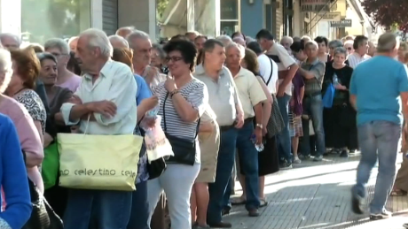 Greek pensioners wait in line on Thursday, July 2, 2015 in Athens, Greece
