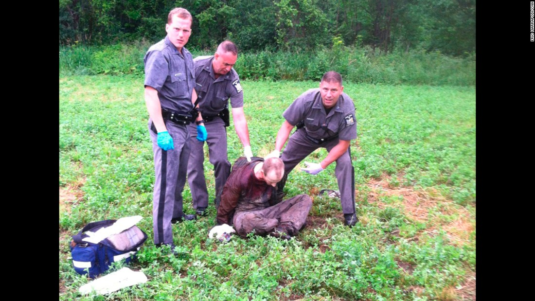 "Police stand over fugitive David Sweat after he was shot and captured in Constable, New York, on Sunday, June 28. Sweat and Richard Matt <a href=""http://www.cnn.com/2015/06/12/us/gallery/new-york-prison-escape-manhunt-photos/index.html"" target=""_blank"">escaped from a maximum-security prison</a> in Dannemora, New York, on June 6. Matt was killed by police on Friday, June 26, two days before Sweat was taken into custody."