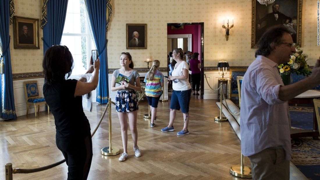 Tourists take photos in the Blue Room of the White House on Wednesday, July 1. The White House now allows photos to be taken during public tours, ending a 40-year-old ban.