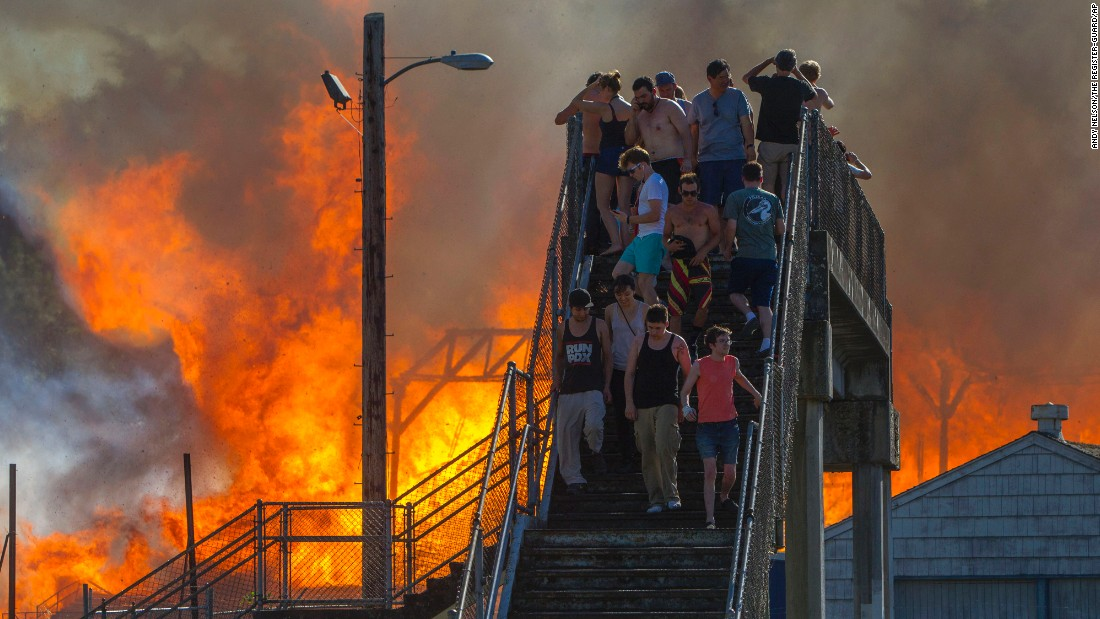 "People in Eugene, Oregon, watch the Civic Stadium go up in flames on Monday, June 29. Four children have been charged with second-degree arson after the historic ballpark was destroyed, <a href=""http://registerguard.com/rg/news/local/33258405-75/police-reveal-details-about-eugene-civic-stadium-fire-started-by-kids-with-lighter-and-leaves.html.csp"" target=""_blank"">according to the Register-Guard newspaper.</a>"