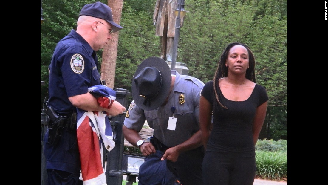 "Bree Newsome is taken into custody after <a href=""http://www.cnn.com/2015/06/27/politics/south-carolina-confederate-flag/"" target=""_blank"">she removed the Confederate battle flag</a> from a monument in front of the South Carolina State House on Saturday, June 27. She was charged with defacing a monument, and a new flag went up within about an hour, according to the South Carolina Department of Public Safety. Not long after she was led away in handcuffs, Newsome became an online hero, a trending topic on social media and the subject of an online fundraiser."