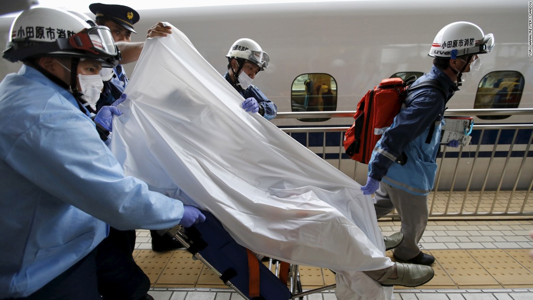 "A bullet train passenger is carried away on a stretcher after an emergency stop in Odawara, Japan, on Tuesday, June 30. Two passengers reportedly died <a href=""http://www.cnn.com/videos/world/2015/06/30/japan-deadly-bullet-train-fire.cnn"" target=""_blank"">after one set himself on fire.</a>"