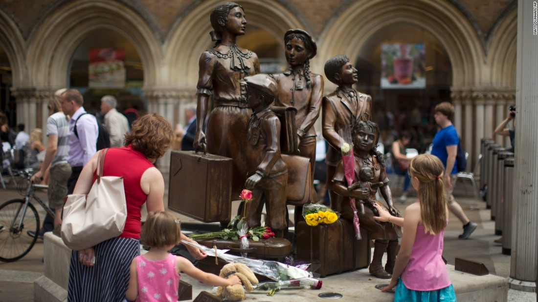 "Flowers are laid at a London statue in memory of Sir Nicholas Winton, who is credited <a href=""http://www.cnn.com/2015/07/01/europe/nicholas-winton-obituary/index.html"" target=""_blank"">with saving hundreds of children from the Holocaust.</a> Winton died Wednesday, July 1, at the age of 106."