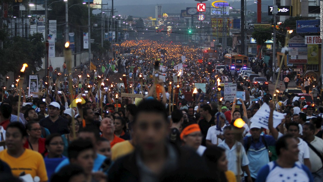 "People in Tegucigalpa, Honduras, take part in a march to demand the resignation of President Juan Hernandez on Friday, June 26. <a href=""http://www.nytimes.com/2015/06/13/world/americas/corruption-scandals-driving-protests-in-guatemala-and-honduras.html?ref=topics&_r=0"" target=""_blank"">Thousands of angry, torch-bearing Hondurans</a> also demanded an independent probe into one of the worst corruption scandals in the country's history."