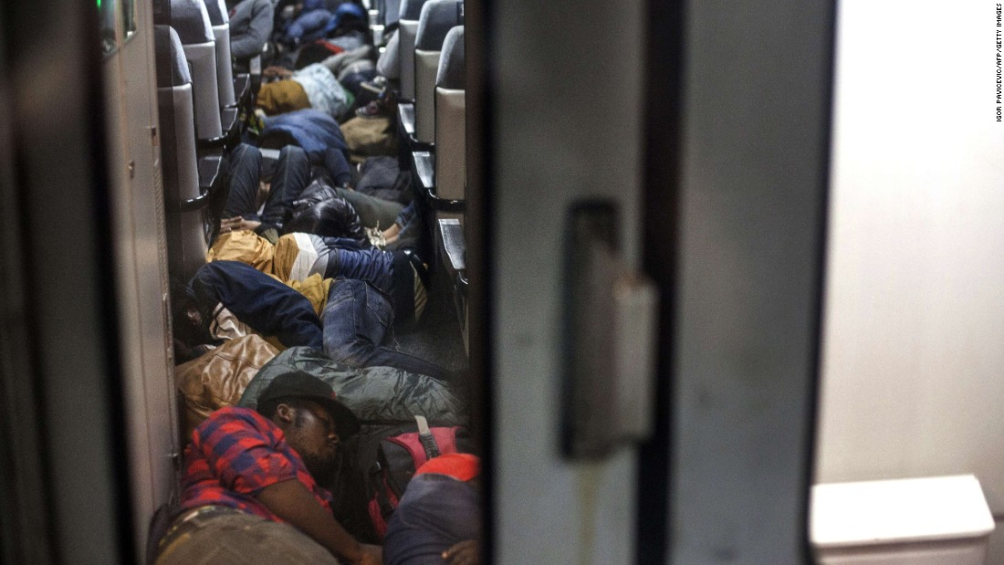 Migrants sleep on a train bound for Subotica, Serbia, which is near the border with Hungary, on Sunday, June 28. Hungary is part of the European Union. Serbia is not.