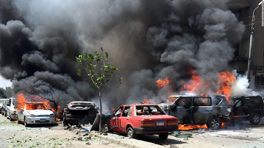 "Smoke and flames rise above burning cars in Cairo at the scene of a bombing <a href=""http://www.cnn.com/2015/06/29/middleeast/egypt-top-prosecutor-explosion/"" target=""_blank"">that killed Egypt's top prosecutor</a> on Monday, June 29. The blast targeted the convoy of Prosecutor General Hisham Barakat and destroyed several cars in the eastern neighborhood of Heliopolis. Six other people were reportedly injured."