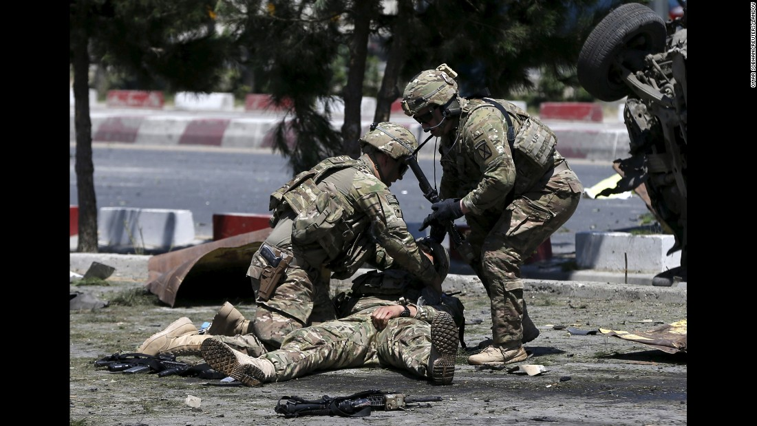 "U.S. troops attend to a wounded comrade at the site of a blast in Kabul, Afghanistan, on Tuesday, June 30. The suicide bombing <a href=""http://www.cnn.com/2015/06/30/asia/afghanistan-violence/"" target=""_blank"">targeted an international convoy in Kabul</a> only hours after a blast rocked a city in Afghanistan's southern Helmand province."