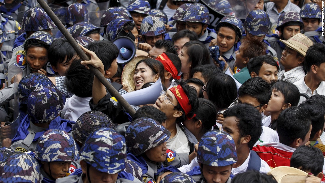 Students in Yangon, Myanmar, try to pass a police line on Tuesday, June 30, as they protest against military representatives in parliament who were appointed by the military commander-in-chief.