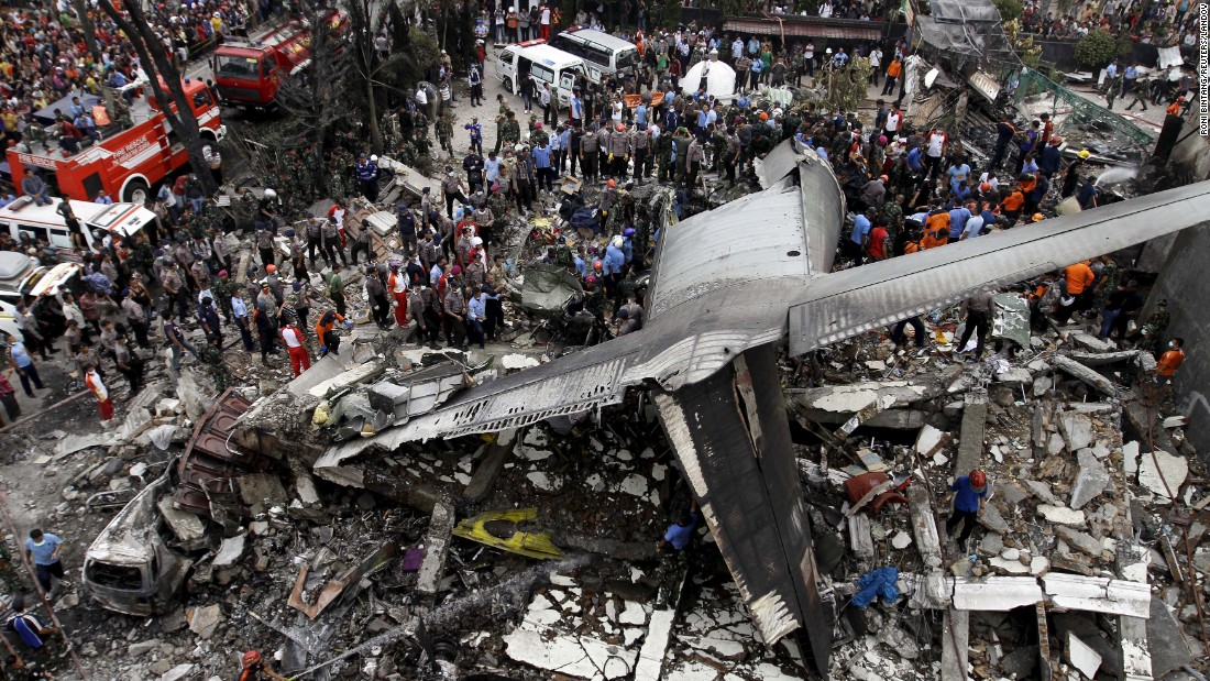 "Security forces and rescue teams examine the wreckage of a military transport plane after it <a href=""http://www.cnn.com/2015/06/30/world/gallery/indonesia-plane-crash/index.html"" target=""_blank"">crashed into a residential area</a> Tuesday, June 30, in Medan, Indonesia. At least 135 people were killed. The plane was carrying military personnel and their family members, as well as students and other civilians."