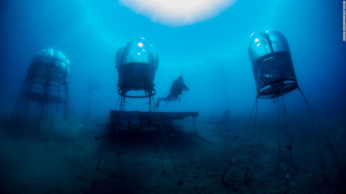 "Gianni Fontanesi checks underwater biospheres in Noli, Italy, on Saturday, June 27. Plants are growing inside the biospheres as part of the experimental <a href=""http://www.nemosgarden.com"" target=""_blank"">Nemo's Garden</a> project."